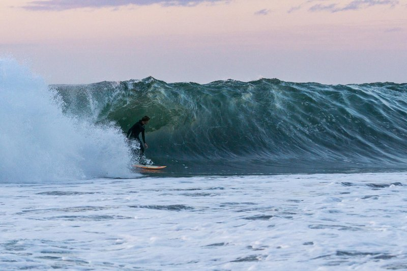 surfer-hank-gaskell-catches-a-sunset-tube-in-chile