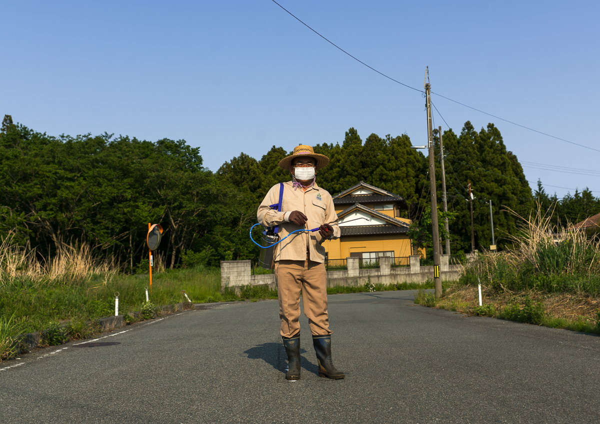 Man coming back in the contaminated area after the nuclear disaster to take care of his house and garden, Fukushima prefecture, Naraha, Japan
