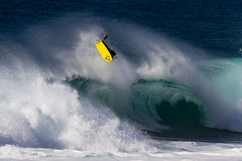Michael_Novy_doing_an_air_reverse_360_at_Backdoor_on_the_island_of_Oahu,_Hawaii.